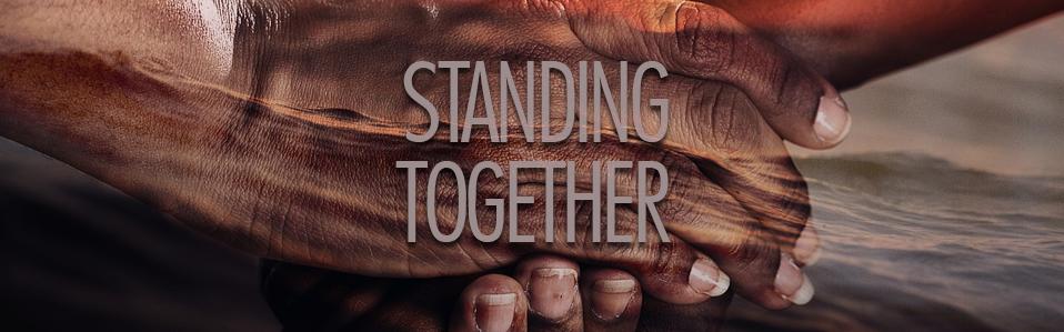 Standing together around Jesus